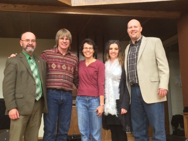 Rotary members, Keith Cerny, Suzanne DeVore, Carol Riggenbach, and Chas Moeller stand with musician Chris Collins (second from left).
